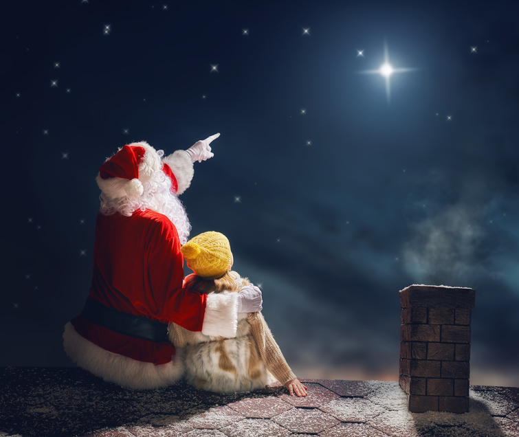 girl and Santa Claus on the roof